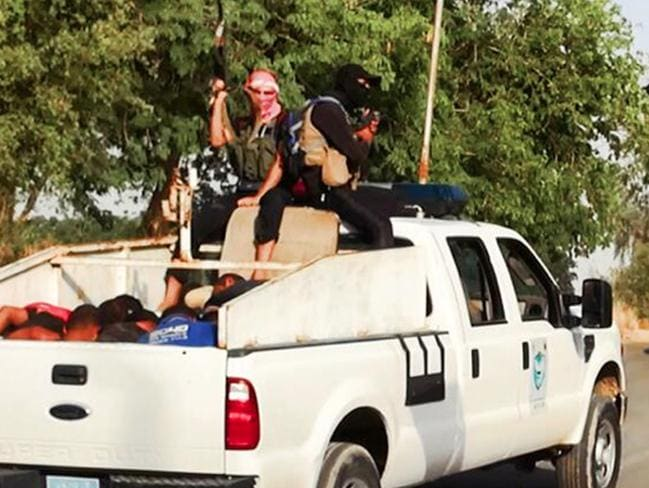 The men are then loaded into utes.