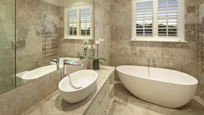 The house features French limestone bathrooms.