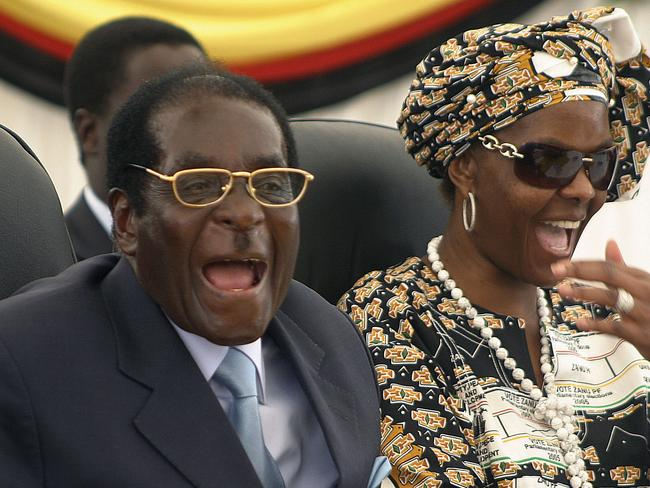 Then Zimbabwean President Robert Mugabe, left, and his wife Grace, right, in 2008. Picture: AP
