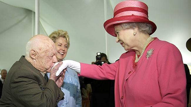 Mickey Rooney greets the Queen during a garden party in 2007.