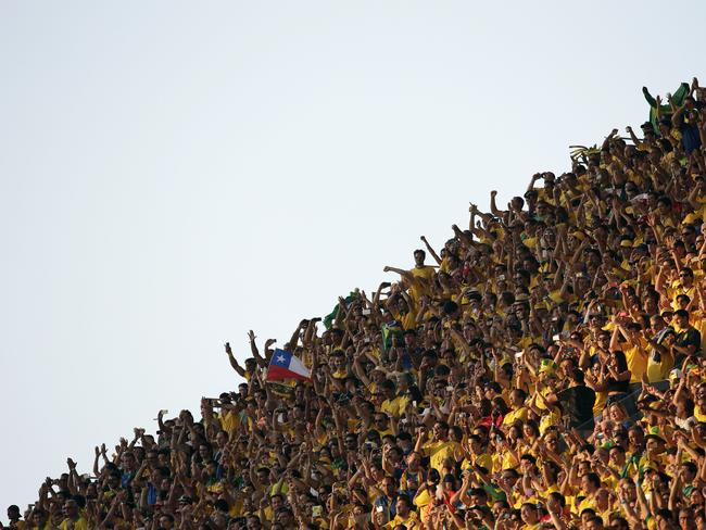 Fans cheer before the opening match between Brazil and Croatia.