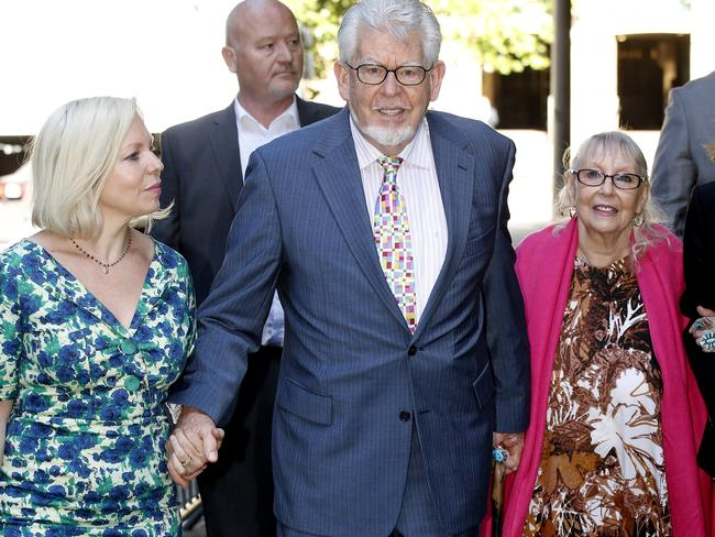 Charged ... Rolf Harrisa at Southwark Crown Court with his wife Alwen Hughes and daughter Bindi on June 10. Picture: Neil Mockford/Alex Huckle/GC Images