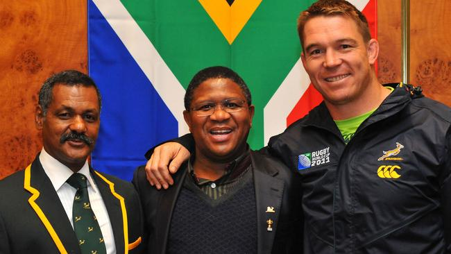 South African Minister of Sport Fikile Mbulula with Peter de Villiers (L) and John Smit (R) after the jersey handover after the captain's run at Wellington Stadium on September 10, 2011.