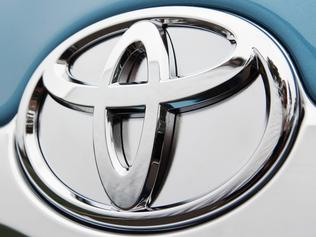 Badge on the 2010 Toyota Camry Hybrid Luxury sedan.