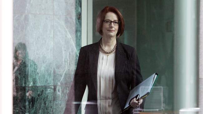 Prime Minister Julia Gillard walks into the Labor caucus meeting at Parliament House.
