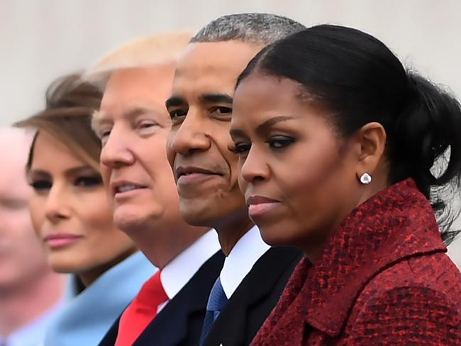 A new era: The Obamas hand over to the Trumps. Picture: Jim Watson/AFP
