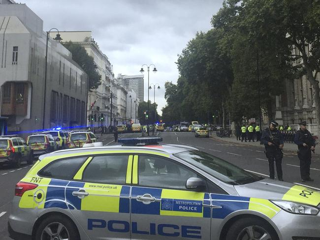 Armed police at the scene on Cromwell Gardens in London, near where people were injured after a car reportedly ploughed into people outside London's Natural History Museum. Picture: AP
