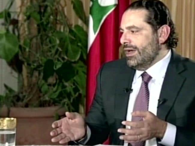 Lebanon's Prime Minister Saad Hariri gives a live TV interview in Riyadh, insisting he will return to his country within days. Picture: Future TV/AP