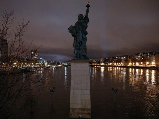 The French replica of the Statue of Liberty on the flooded Ile aux Cygnes (Swans Island) by the banks of the Seine river. Picture: AFP