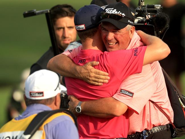 Justin Thomas gets a hug from his dad after his PGA title success.