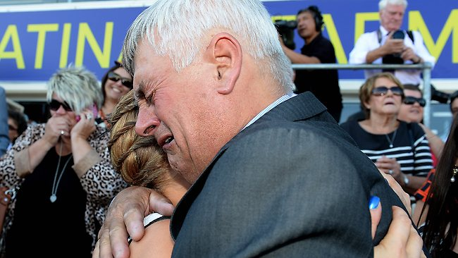 Lauren Stojakovic's father, Nenad, embraces a friend after his daughter rode the race of her life to land Miracles Of Life a winner over some of the biggest names in racing. Picture: Wayne Ludbey