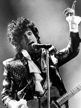 Prince gets wild in 1985. Picture: AP Photo/Rob Burns