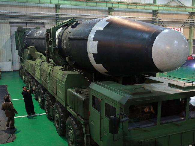 North Korean leader Kim Jong-un inspects the Hwasong-15 intercontinental ballistic missile prior to its launch last week. Picture: KCNA/AP