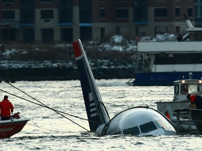 Rescue boats float next to a US AirwaysAirbus 320 plane which crashed into the Hudson River on January 15, 2008. Picture: Chris McGrath/Getty Images/AFP