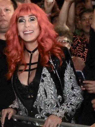 Cher watched on with the crowd before joining the parade.