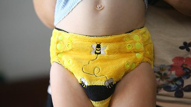 Toilet-training taking longer ... Two-year-old Ned Foley showing off a Bumble Bee nappy.