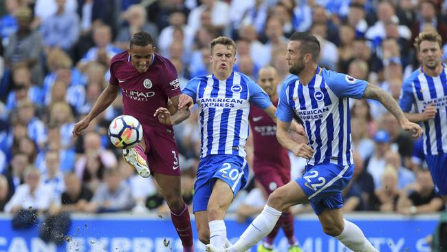 Manchester City's Danilo, left, and Brighton & Hove Albion's Solly March.