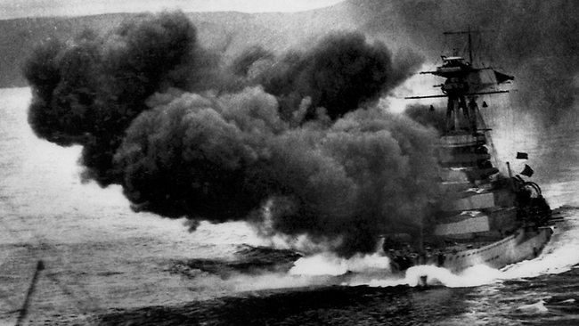 The British battleship HMS Royal Oak as she fires a salvo from her main armament during World War One.