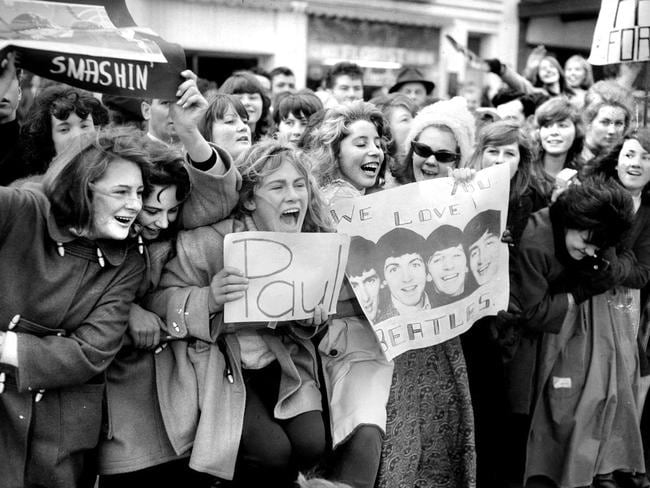 June 14, 1964: Many of the screaming teenage fans had made their own welcome signs. Picture: Herald Sun Image Library