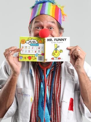 Dr Munjong (aka Derek Nannup) reading his Mr Funny book from the Mr Men series. Photo Ross Swanborough.