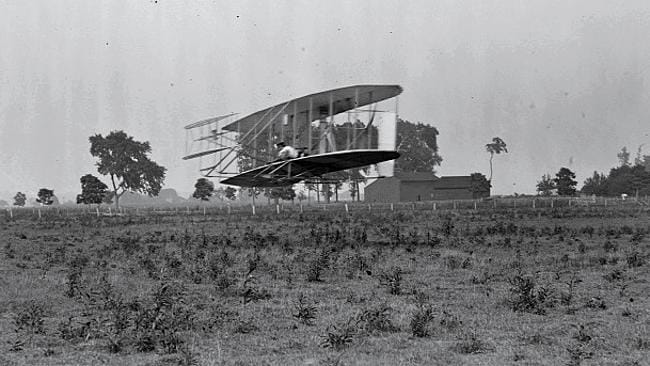 Orville Wright pilots an aircraft across Huffman Prairie Flying Field. Picture: US Library of Congress