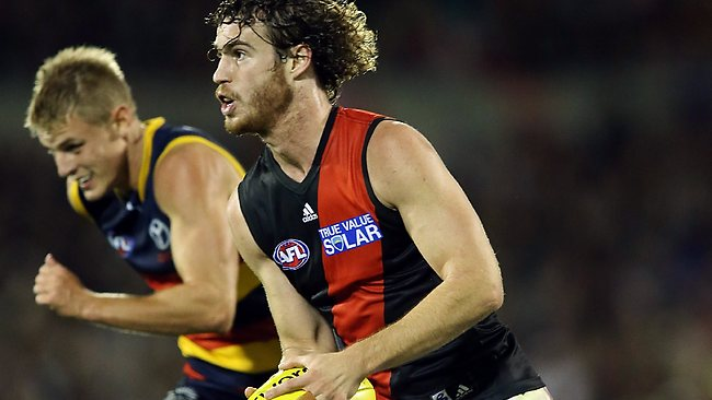 Essendon's Nick Kommer runs through the middle of AAMI Stadium.