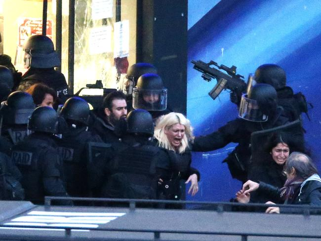 Free ... French police special forces evacuate the hostages after launching the assault at a kosher grocery store in Porte de Vincennes, eastern Paris. Picture: Snapper Media