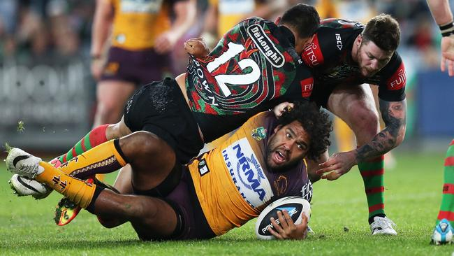 Ben Te'o's chicken wing on Sam Thaiday. Picture: Phil Hillyard