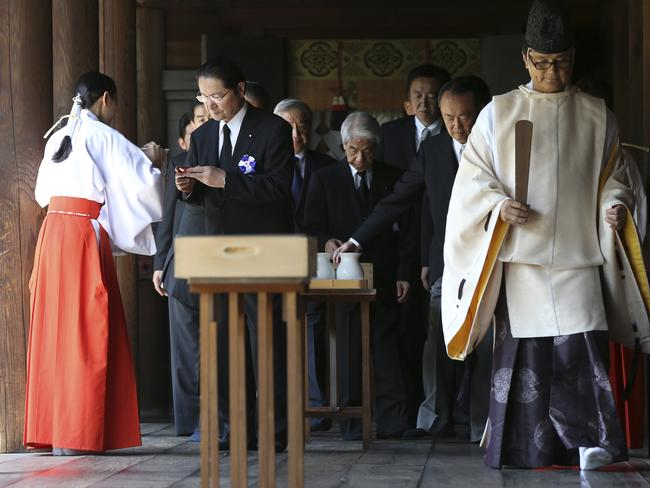 Historic site ... a group of Japanese politicians prepare to sip a cup of rice wine after paying respects to the war dead at Yasukuni Shrine in Tokyo. Picture: AP/Eugene Hoshiko
