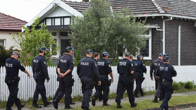 Police from the NSW Public Order and Riot squad arrive at the scene this morning. Picture: AAP