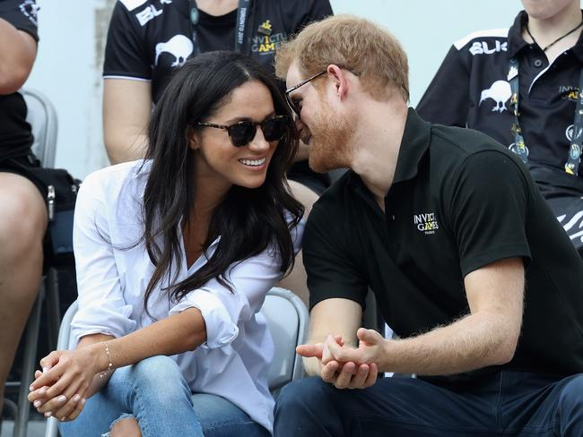 Prince Harry and Meghan Markle share a moment together during the Invictus Games. Picture: Getty
