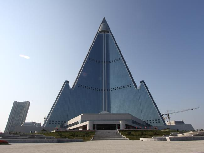 The pyramid-shaped, 105-story Ryugyong Hotel stands in Pyongyang, North Korea as a tourist drawcard.