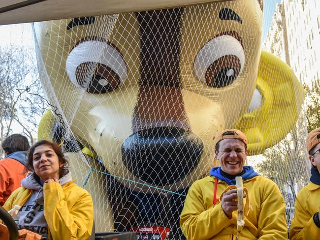 Workers on the Macy's inflation teams take a break near balloons for the Macy's Thanksgiving Day parade. Picture: Getty
