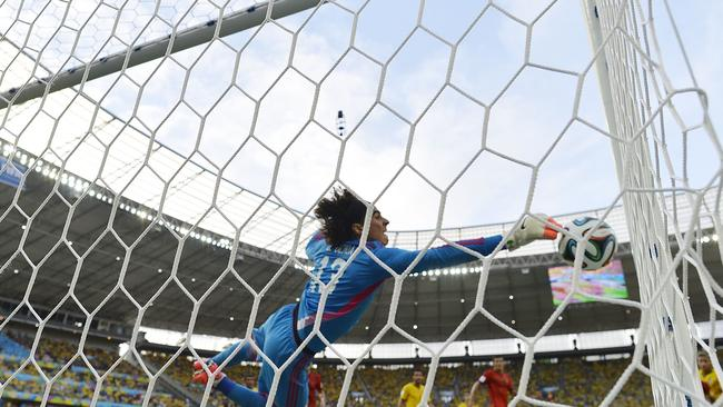 Mexico's goalkeeper Guillermo Ochoa pulls off the save of the tournament so far.