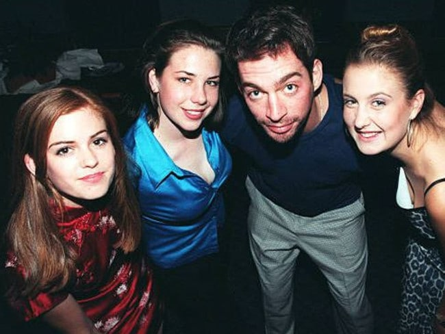 Isla Fisher, Kate Ritchie and Tempany Deckert with American singer Harry Connick Jr in 1996. Picture: Getty