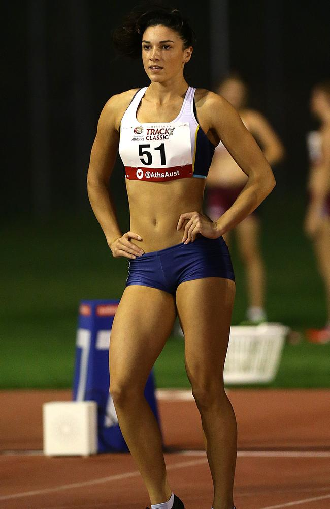 Michelle Jenneke does her hip jiggle during a meet in Brisbane. Picture: Jono Searle.