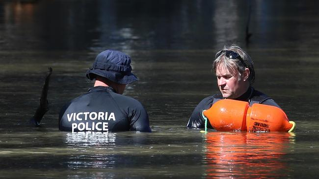 Victorian police divers search the Murray River for a missing boy on Friday, March 3, 2017, in Moama, New South Wales, Australia. The child's body was found in the river the following morning. Picture: Hamish Blair