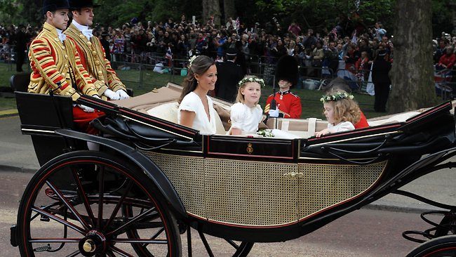 Pippa gets to share in the fairytale magic as she rides in an open carriage to Buckingham Palace. Picture: AFP