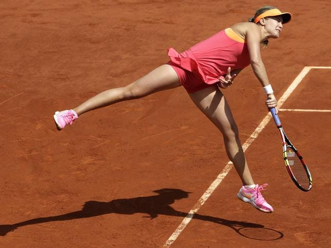 TCanada's Eugenie Bouchard serves to Russia's Maria Sharapova during their French Open semi-final.