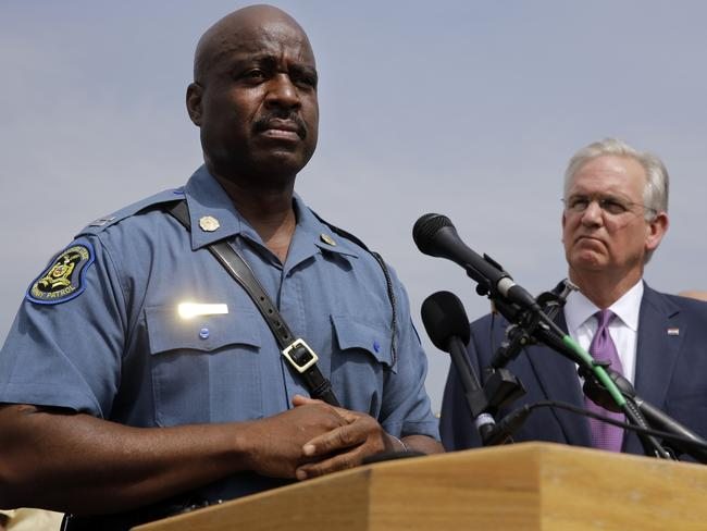In charge ... Captain Ron Johnson of the Missouri Highway Patrol, left, and Missouri Govenor Jay Nixon take part in a news conference. Picture: AP Photo/Jeff Roberson