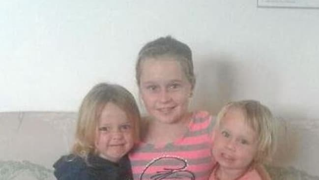 Jade Carney with her younger siblings.