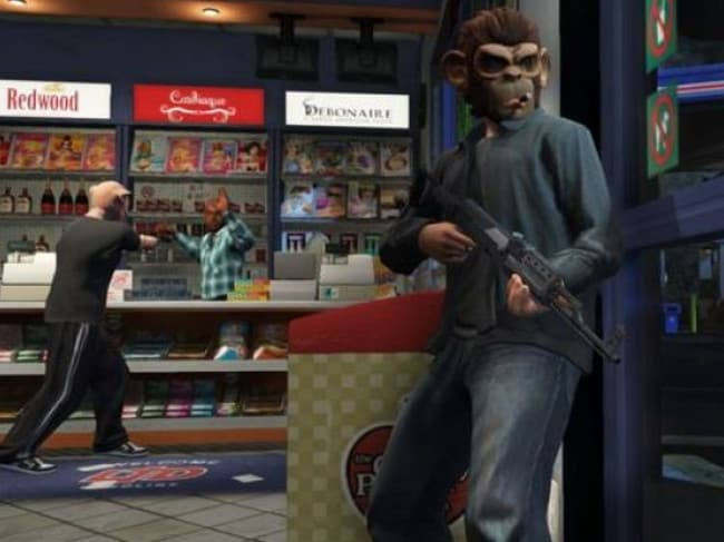 "Just a game? ... Players hold up a gas station in GTA5. Lovers of the game say the petitioners should leave their ""innocent hobby"" alone."