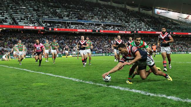 Daniel Tupou scores for the Roosters.