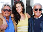 Megan Gale, who was giving away petrol on behalf of David Jones at Mobil in Pulteney St, with Harry Watt and George Gross in 2008. Picture: Nat Thompson