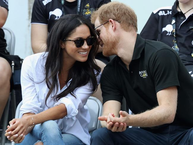 Prince Harry and Meghan Markle attend a wheelchair tennis match during the Invictus Games. Picture: Chris Jackson/Getty Images for the Invictus Games Foundation