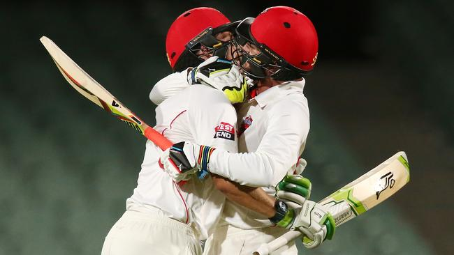 Jake Lehmann and Chadd Sayers of the Redbacks celebrate.