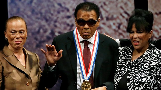 Retired boxing champion Muhammad Ali waves alongside his wife Lonnie Ali, left, and his sister-in-law Marilyn Williams, right, after receiving the Liberty Medal during a ceremony at the National Constitution Centre last September.