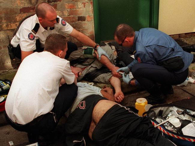 Paramedics use Narcan to revive a heroin overdose victim in Sydney's Kings Cross in 1999. Picture: Peter Barnes