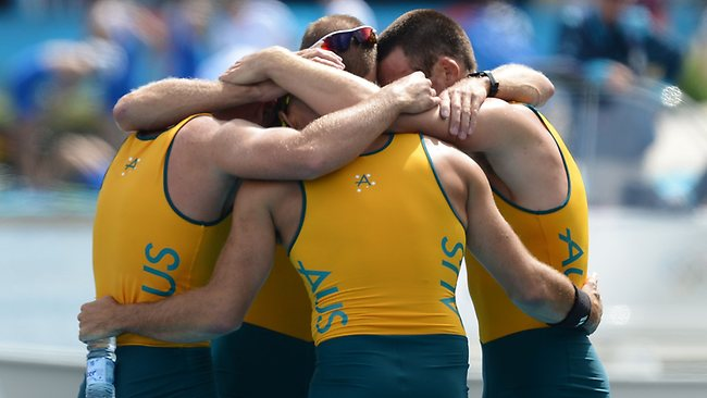Australia's William Lockwood, James Chapman, Drew Ginn and Joshua Dunkley-Smith embrace after winning the silver medal in the men's four final.