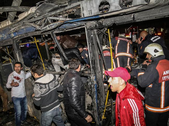 Emergency workers work in a bus at the explosion site. Picture: Elif Sogut/Getty